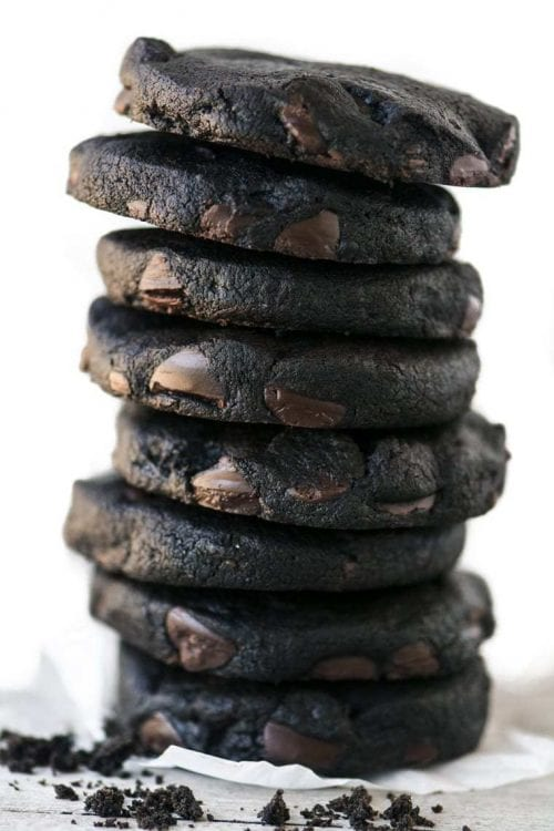 close up of a stack of dark chocolate short bread cookies
