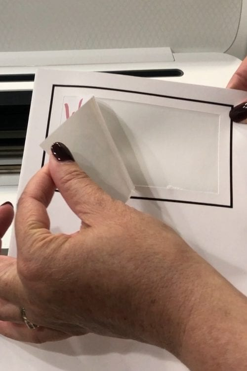 removing the print then cut sticker from the printable sticker paper