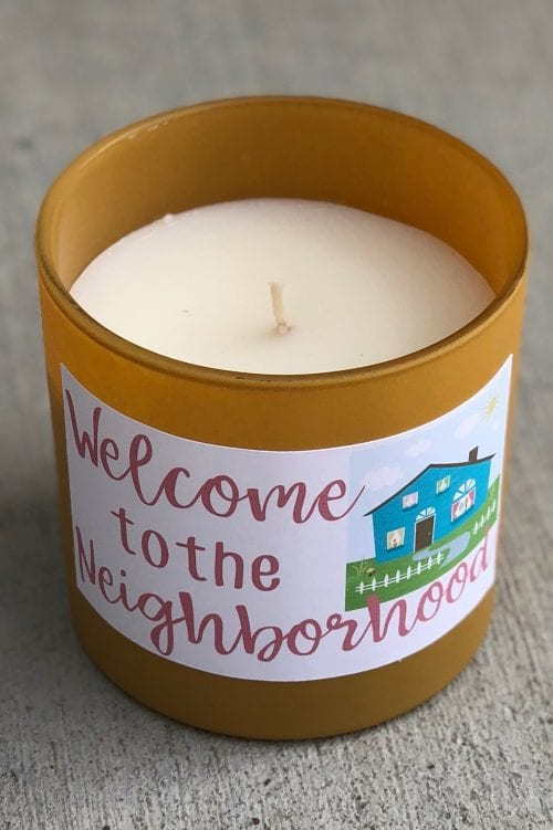 a close up of a neighbor gift of a candle with a print then cut sticker