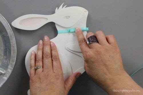 adding a ribbon bow to the neck of the 3d paper art bunny