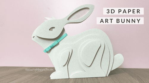 finished layered paper art bunny with a pink background
