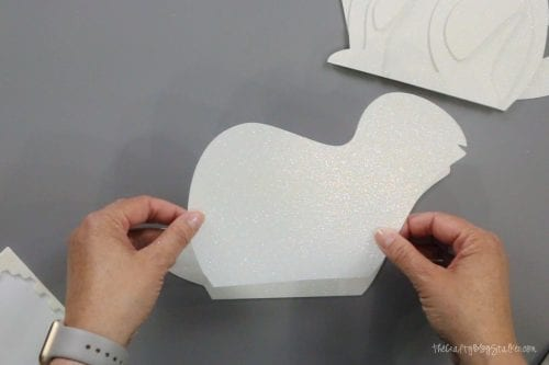 layering the pieces of the 3d paper art bunny