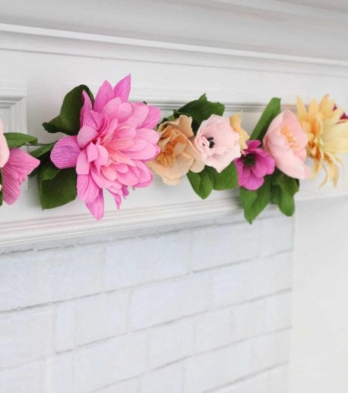 15 Fantastic Paper Flower Garlands for Weddings featured by top US craft blog, The Crafty Blog Stalker: image of a crepe paper flower garland