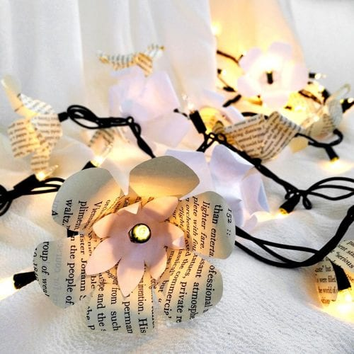 15 Fantastic Paper Flower Garlands for Weddings featured by top US craft blog, The Crafty Blog Stalker: image of a flowers and lights garland