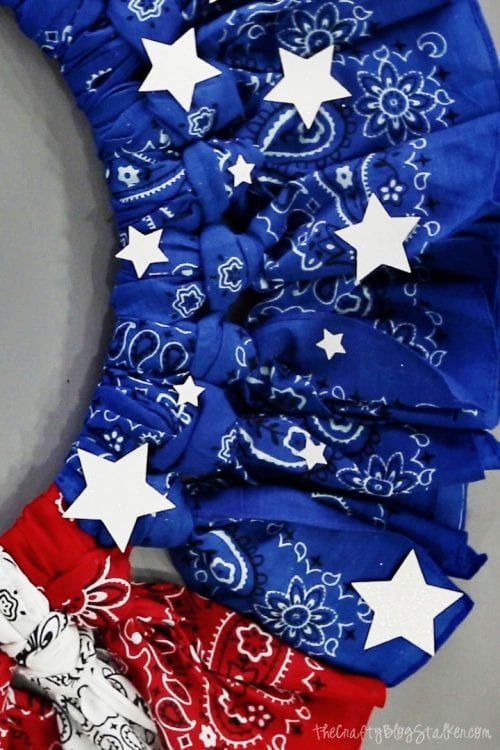 How to Make a 4th of July Bandana Wreath featured by top US craft blog, The Crafty Blog Stalker - glitter stars glued onto the bandana wreath