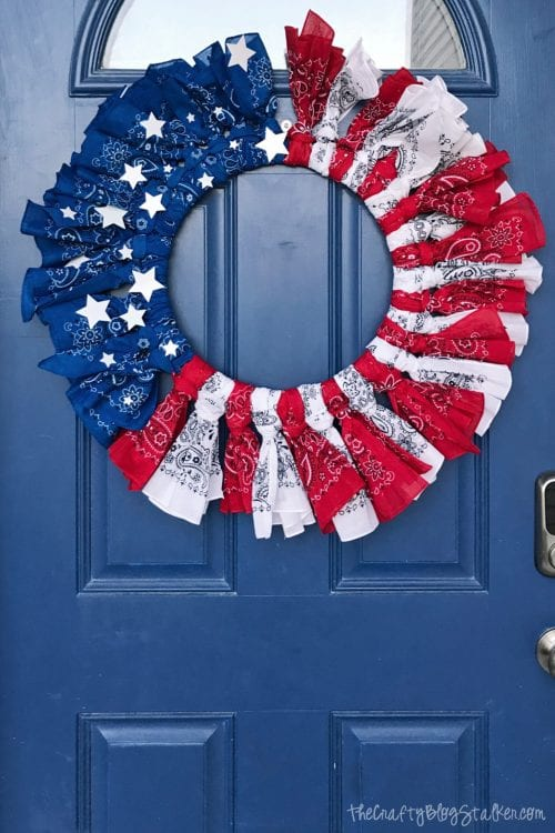How to Make a 4th of July Bandana Wreath featured by top US craft blog, The Crafty Blog Stalker - 4th of July Bandana Wreath hanging on a front door