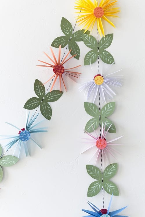 15 Fantastic Paper Flower Garlands for Weddings featured by top US craft blog, The Crafty Blog Stalker: image of a paper flower garland