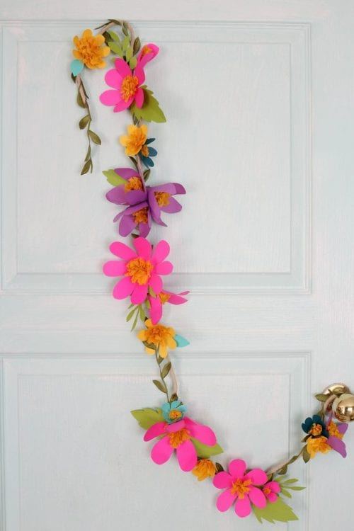 15 Fantastic Paper Flower Garlands for Weddings featured by top US craft blog, The Crafty Blog Stalker: image of a colorful paper flower garland