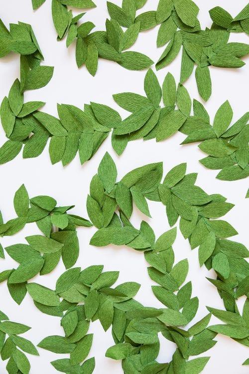 15 Fantastic Paper Flower Garlands for Weddings featured by top US craft blog, The Crafty Blog Stalker: image of a crepe paper leaf garland