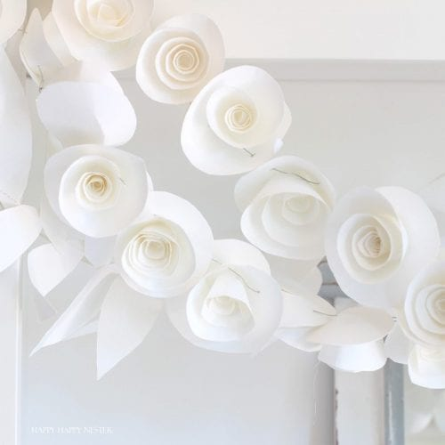15 Fantastic Paper Flower Garlands for Weddings featured by top US craft blog, The Crafty Blog Stalker: image of a rose and leaves paper flower garland