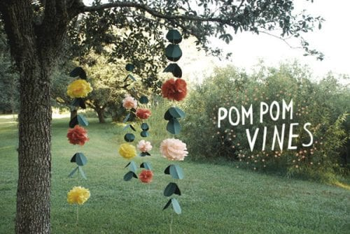 15 Fantastic Paper Flower Garlands for Weddings featured by top US craft blog, The Crafty Blog Stalker: image of a tissue paper pom pom vines garland