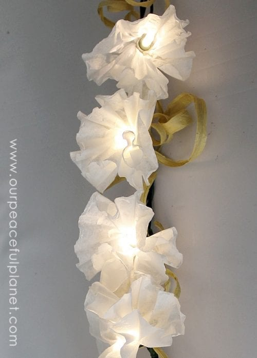 15 Fantastic Paper Flower Garlands for Weddings featured by top US craft blog, The Crafty Blog Stalker: image of a coffee filter lights garland