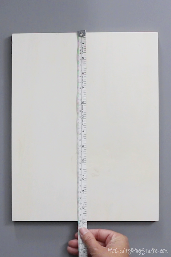 image of measuring a blank wood sign