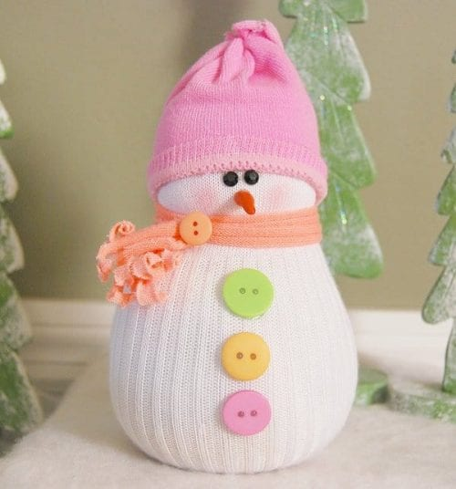 20 Sock Craft Ideas to make with Mismatched Socks featured by top US craft blog, The Crafty Blog Stalker: sock snowman