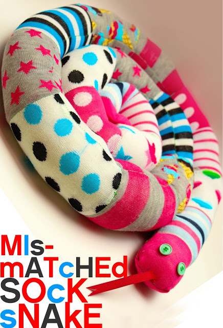 20 Sock Craft Ideas to make with Mismatched Socks featured by top US craft blog, The Crafty Blog Stalker: mismatched sock snake