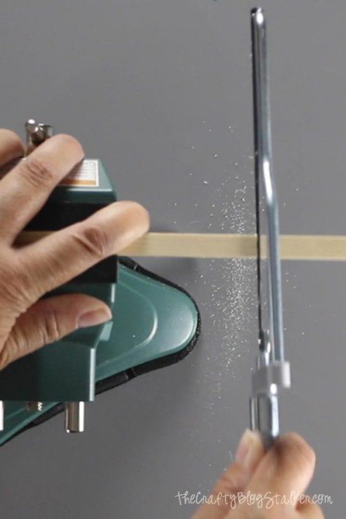 a hand saw and vice cut a wood dowel