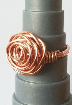 20 Handmade Ring Tutorials: DIY Jewelry Ideas featured by top US craft blog, The Crafty Blog Stalker:Wire Wrapped Rose Ring