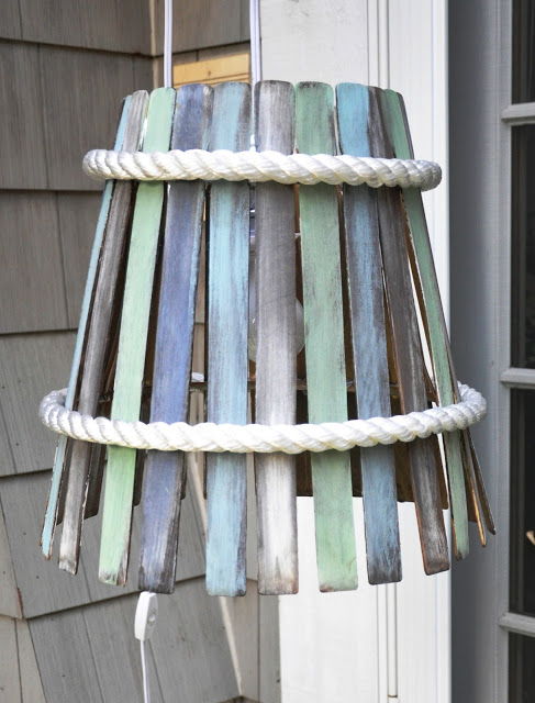 Top 20 DIY Lampshade Ideas to Lighten Up a Room featured by top US craft blog, The Crafty Blog Stalker: image of paint stir stick lampshade