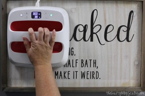How to Make a Cricut Explore Air 2 Project Idea You'll Love, a funny bathroom sign tutorial featured by top US craft blog, The Crafty Blog Stalker.