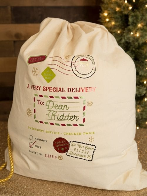 25 Cricut Personalized Gifts featured by top US craft blog, The Crafty Blog Stalker: personalized santa bag.