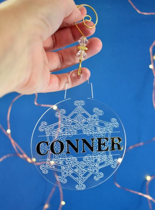 25 Cricut Personalized Gifts featured by top US craft blog, The Crafty Blog Stalker: engraved Christmas ornaments.