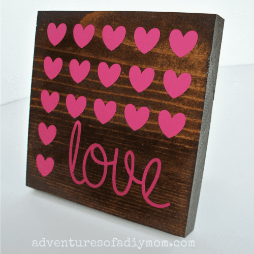 20 Sweet and Loving Valentines Decoration Ideas featured by top US craft blog, The Crafty Blog Stalker: wood valentines sign.