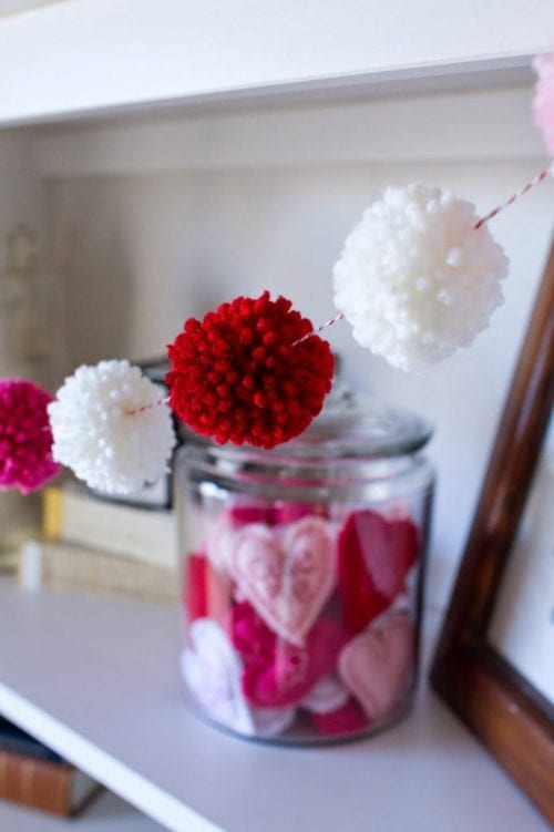20 Sweet and Loving Valentines Decoration Ideas featured by top US craft blog, The Crafty Blog Stalker: Valentines pom pom garland.