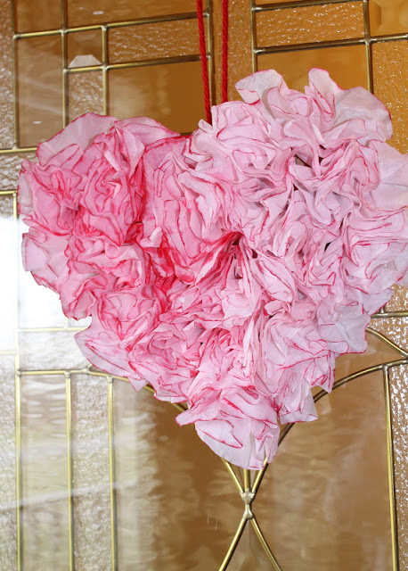 20 Sweet and Loving Valentines Decoration Ideas featured by top US craft blog, The Crafty Blog Stalker: coffee filter heart wreath.
