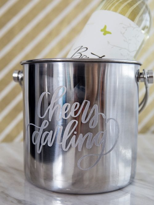 20 Personalized DIY Wedding Gifts for Newlyweds you Can Make with a Cricut, featured by top US craft blog, The Crafty Blog Stalker: Personalized Wine Bucket