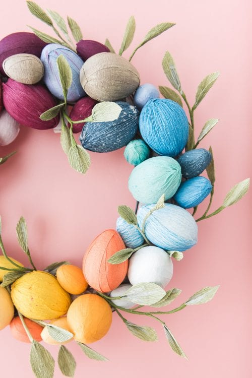 20 Fun DIY Easter Decor Ideas featured by top US craft blog, The Crafty Blog Stalker: Rainbow Easter Egg Wreath