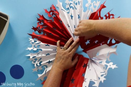 flattening the accordion to create the Large DIY Patriotic Paper Rosette