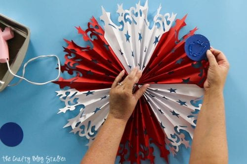 hot glue circle to the center of the Large DIY Patriotic Paper Rosette to hold it all together