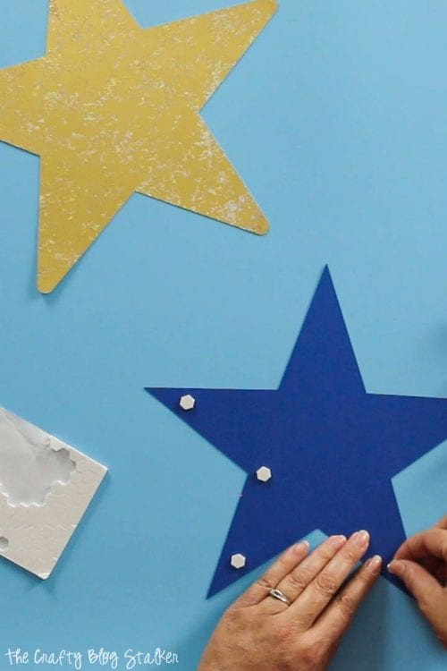 applying foam adhesive dots to a star for the Large DIY Patriotic Paper Rosette