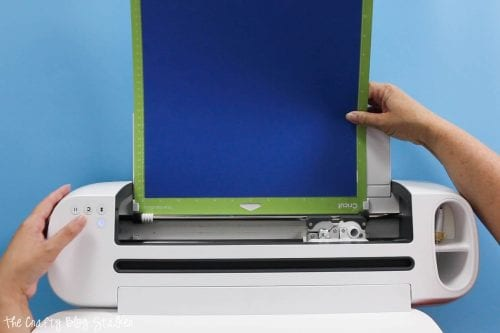 loading blue cardstock into the Cricut Maker