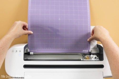 loading a StrongGrip mat into a Cricut Maker