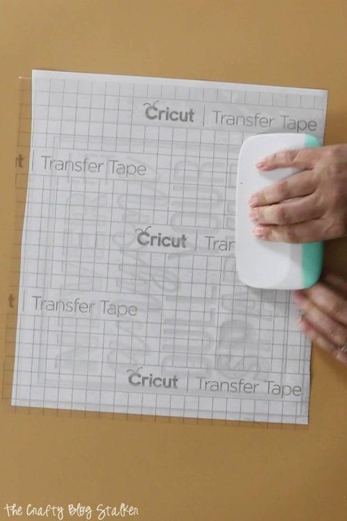image of applying transfer tape to vinyl
