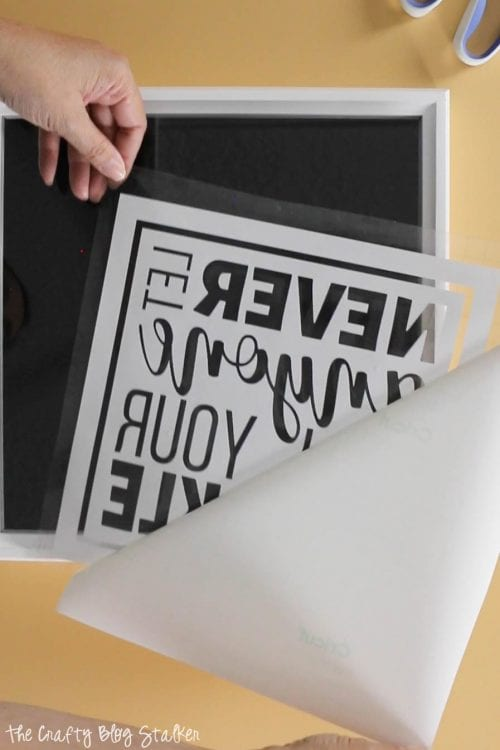 image of removing vinyl backing from design