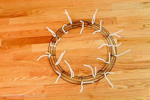 pipe cleaners on a wire wreath frame