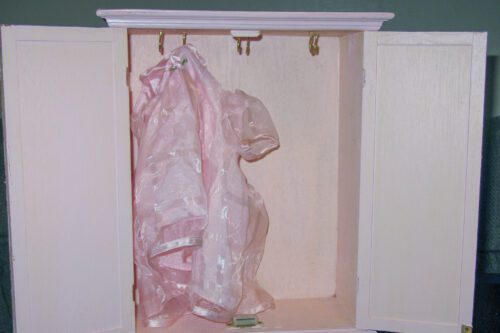 hanging bear clothes in the wardrobe