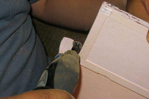 sanding the edges of the door