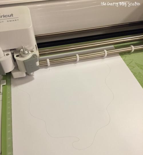 cutting the design with a Cricut