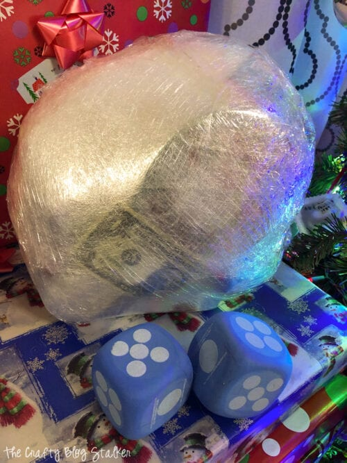 Christmas Plastic Wrap Game with a pair of oversized dice