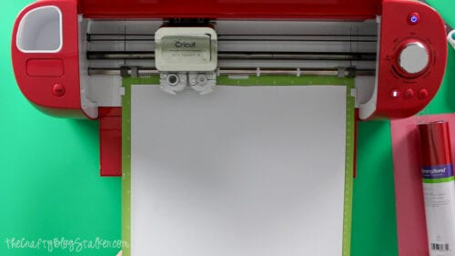 the cricut cutting the design out of heat transfer vinyl