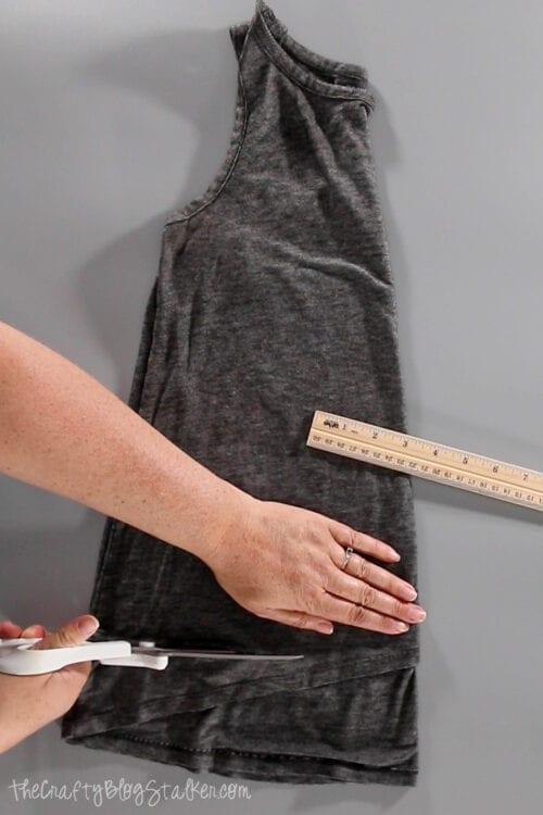 cutting the bottom seam off of a tshirt