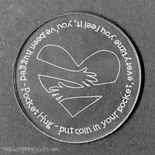 finished pocket hug coin engraved with the cricut maker