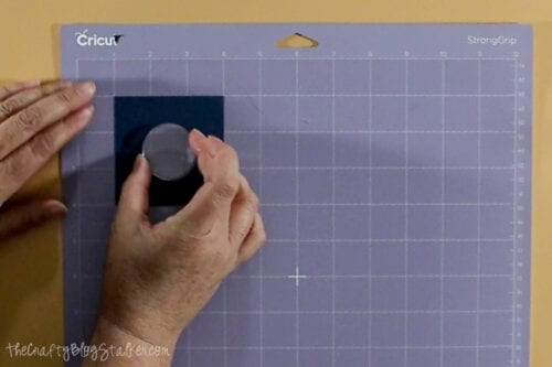 placing the acrylic coin on the StrongGrip Mat