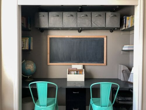 Small Space Office Closet Desk with Build In Book Shelves and Industrial Pipe Storage Shelves