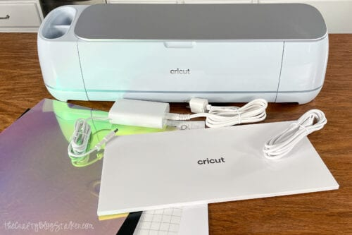 the Cricut Maker 3 and the contents of the box
