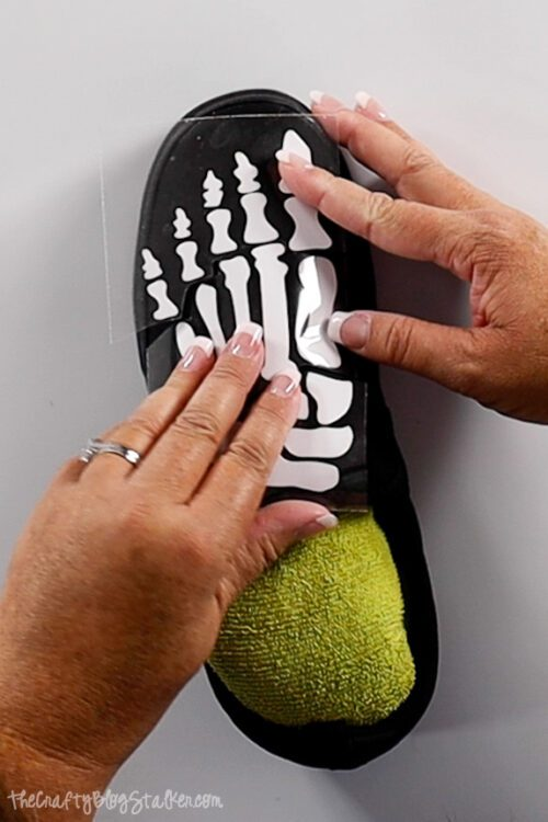 placing the iron-on onto the shoe