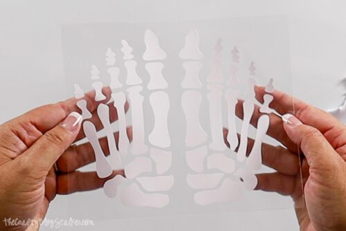 skeleton feet cut out of iron-on vinyl